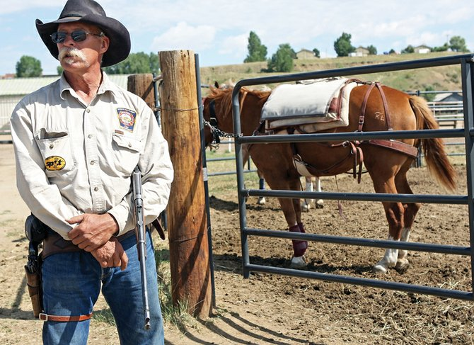 Idaho resident Phil Dawson, who is making a 7,500-mile trip across the U.S., hit a roadblock July 24 when one of his horses was injured. Although the injury sets his trip back, Dawson said the assistance of people like Turner DuPont and Sandra Gardner, who are Moffat County residents, will help him get back on the road.