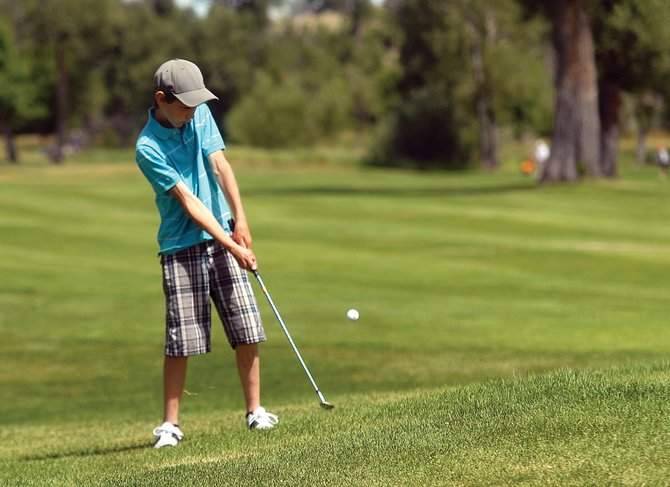 Casey Nations hits his ball onto the green Tuesday during the Yampa River Junior Classic at Yampa Valley Golf Course in Craig. The tournament included 49 golfers up to 17 years old, who were competing for trophies in the youth tournament.