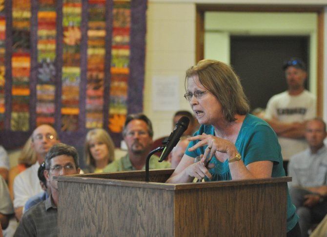 "Steamboat Springs resident Virginia Cannon voices her opposition to a proposed gravel pit south of Steamboat at a public meeting in front of the Routt County Board of Commissioners on Tuesday. ""Gravel operations are not compatible with agricultural operations and the environment,"" Cannon said."