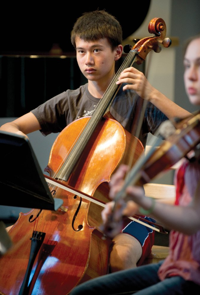 Alexander Nunn, of Arizona, plays the cello during a session for The Lowell Whiteman School's Rocky Mountain Sum­mer Conservatory music program. The young musician and several other students were running through a rehearsal for a performance this weekend.