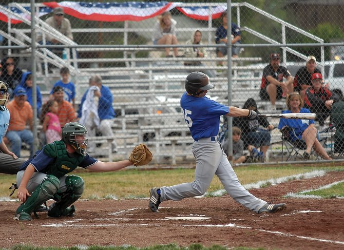 Bubba Ivers connects with a pitch in the first inning of the American Legion Post 62 baseball game versus Fleming on Thursday at Craig Middle School. The No. 7 seeded Bulldogs dropped their first game of the state tournament, 13-3, to the No. 2 seeded Rattlers.