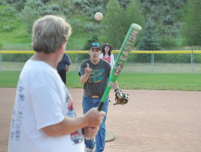 Jesse Rudnick pitches the ball to Jeff Dockstader at the Steamboat Pirate's softball practice Monday. The Pirates leave Saturday to compete in the Mile High Classic Special Olympics softball tournament in Lakewood.