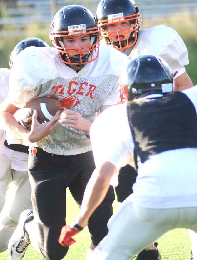 Hayden High School sophomore Mark Doolin runs the ball Friday during a football scrimmage against Steamboat Springs.