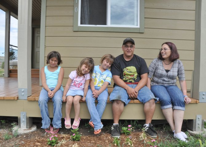 The Archuleta family, from left, is Brisha, 10, Hailey, 4, Shelby, 9, Levi and Amanda. The family moved into their new home built by Routt Countys Habitat for Humanity in December.