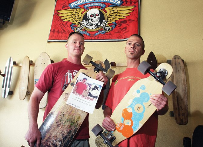 Kenny Stacy, left, and Jim Diehl hold skateboards July 23 that belonged to the late Shane Braselton. Stacy and Diehl helped organize the second annual Lid Jam in memory of Braselton, and to raise safety awareness in the local skateboarding community. Lid Jam is scheduled for 6 to 9 p.m. Sunday at the skate park at the corner of Baker Drive and Ashley Road in Craig.