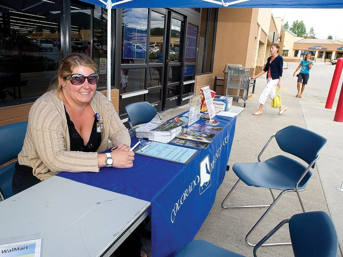 Stephanie Fletcher, administrative assistant for student affairs for Colorado Mountain College, has been camped in front of Walmart in Central Park Plaza to answer questions and help people register for the upcoming semester.