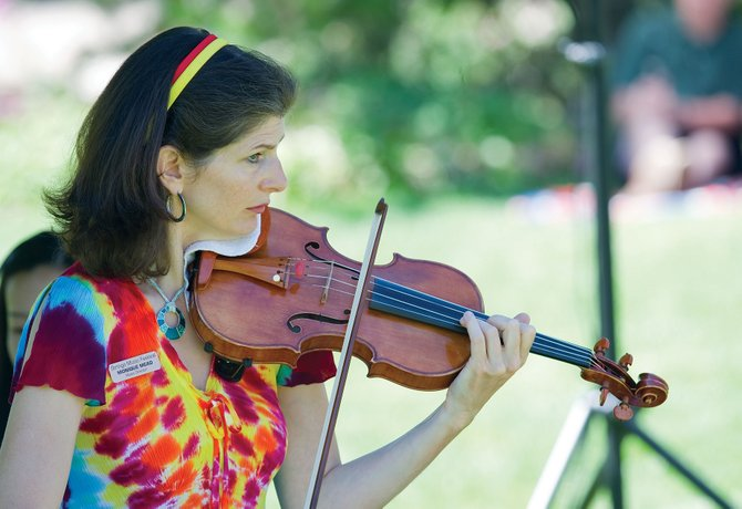 Monique Mead, music director for the Strings Music Festival, performs during Music on the Green earlier this summer. She will perform at 4:30 p.m. Sunday at Strings Music Pavilion as part the Free Community Matinee Concert.