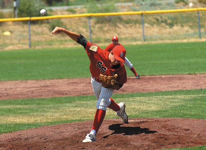 Alan Capistron fires a pitch in the second inning of Thursdays American Legion Post 44 game against Strasburg in the opening round of the American Legion state tournament. Steamboat lost, 5-2.