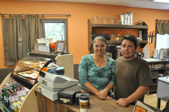 Tasha and Al Compos own and operate the newly renovated Spill the Beans Espresso Cafe on 13th Street.