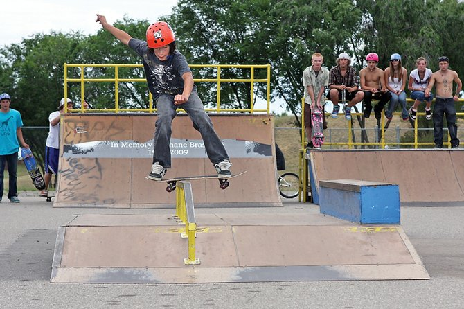 Shandon Hadley, 13, boardslides the rail during the second annual Lid Jam on Sunday at the Craig skate park. The event's goal was to raise helmet awareness and was also in memory of Craig skateboarder Shane Braselton who died about a year ago in a skating accident.