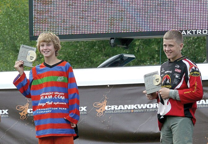 Steamboat Springs' Jack Vanderbeek, left, who won his age division in the super downhill, and teammate Robi Powers, who was second, stand on the podium at Crankworx in Winter Park last week.