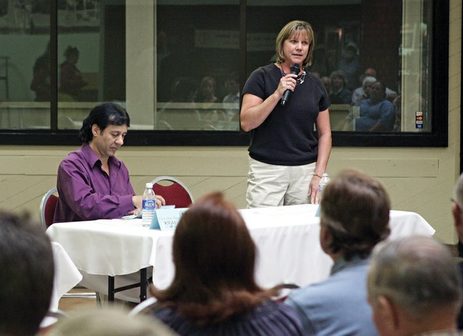 Moffat County assessor candidates Carol Scott, right, and Robert Razzano share the floor Tuesday night during the Craig Daily Press/KRAI candidate forum at Centennial Mall. About 150 local residents attended the event to listen to18 candidates running for local, state and federal offices.