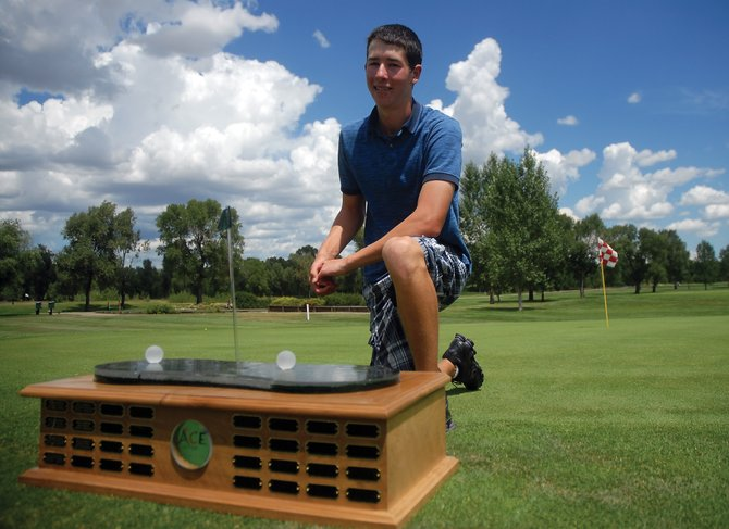 Parker King, shown here Tuesday with his trophy at Yampa Valley Golf Course, finished first overall during the Ace High School Golf Tournament on Monday in Rifle. King, who is entering his junior year at Moffat County High School, shot 77 overall to take first.