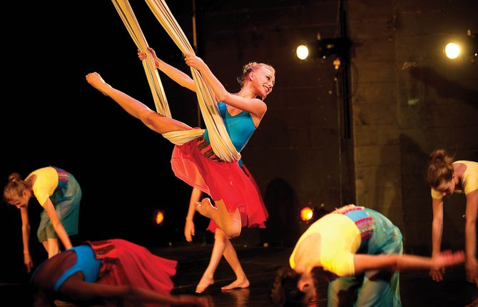 "Dancer Katie Wolfe swings over the heads of fellow dancers at the Julie Harris Theatre during the Perry-Mansfield Youth Festival on Wednesday evening. The festival included four dance pieces and the musical ""The Water Knows My Name."""