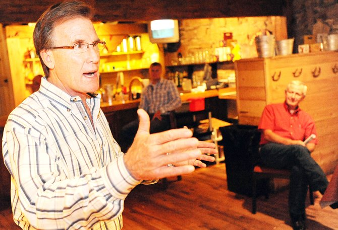 Scott McInnis, a Republican candidate for Colorado governor, talks Friday at Steamboat Smokehouse in downtown Steamboat Springs.