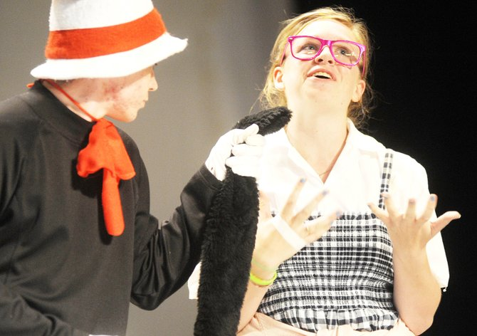 "Sara Pugh, playing Gertrude McFuzz, sings to Christian Weeden's Cat in the Hat character during a dress rehearsal for ""Seussical Jr.,"" a Steamboat Players production that is set to open Thursday in the Steamboat Springs High School auditorium. For the full story, see page 4."