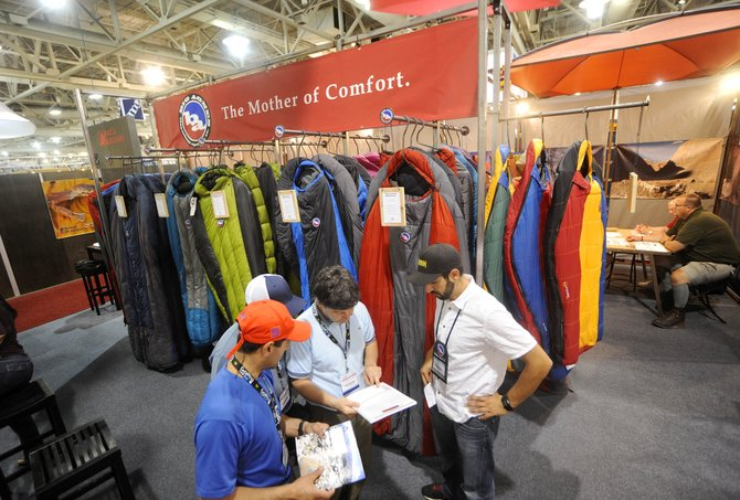 Chris Tamucci, international sales manager for Big Agnes and Honey Stinger, answers questions from South American buyers Tuesday during the Outdoor Retailer Summer Market 2010 trade show in Salt Lake City.