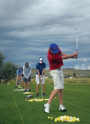 The Moffat County High School boys golf team had its first fall practice of the season Monday at Yampa Valley Golf Course in Craig. Here, players take turns trying to chip shots into a bucket 50 yards out on the driving range.
