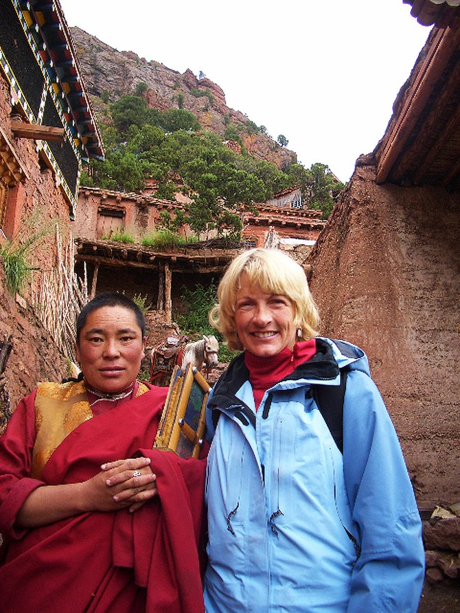 Julie Green, right, of Steamboat Springs, stands with a Tsoknyi Nangchen nun in Tibet during a July 2005 trip.