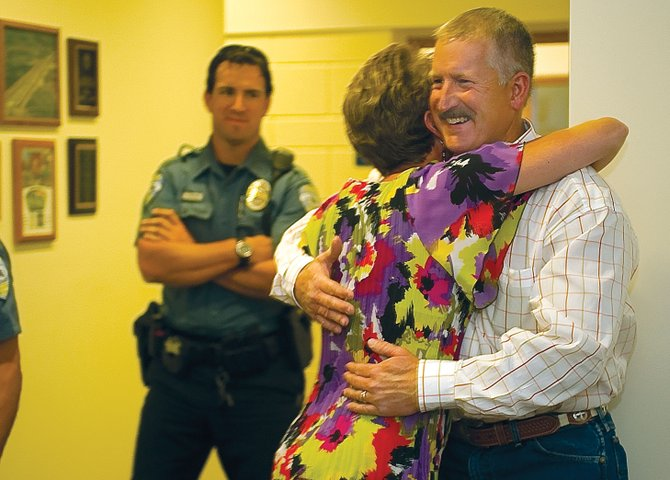 Garrett Wiggins celebrates winning Tuesday's primary by hugging his wife, Melinda, after the results were announced at the Routt County Courthouse.