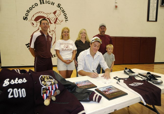 Soroco High School graduate Alex Estes signs his letter of intent to attend Adams State College, where he will jump for the track team. Estes was joined by, from right, his 8-year-old brother Nicholas, father Rodney, mother Tammy, jumping coach Kim Bruner and head coach David Bruner.