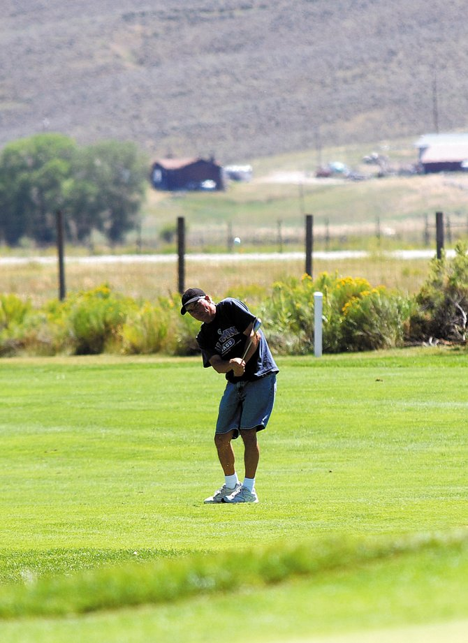 Austin Zimmerman hits a chip shot onto the green on the sixth hole Friday at Yampa Valley Golf Course in Craig. The golf course's club championship begins at 7:30 a.m. today.