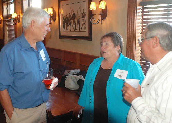 Dr. Jim Dudley, left, chats Wednesday with Jo and Jim Stanko during a party at the Old Town Pub announcing the 2010 Doc Willett Health Care Heritage Awards. Dudley will receive the health care professional award, and Steve Dawes will receive the health care advocate award during a public celebration Sept. 1. Jim Stanko is the grandnephew of pioneer Steamboat Dr. Frederick E. Willett.