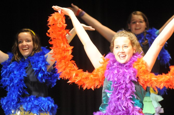 "Lauren Peterson lead's ""The Bird Girls"" in a song during a dress rehearsal for the musical ""Seussical Jr.,"" which starts at 7 p.m. today at Steamboat Springs High School."