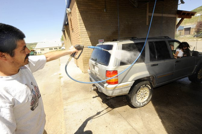 Steamboat Springs resident Alejandro Chavez washes his car Saturday at a car wash on the west side of town. More than $70 million worth of water and wastewater improvements are facing the city.