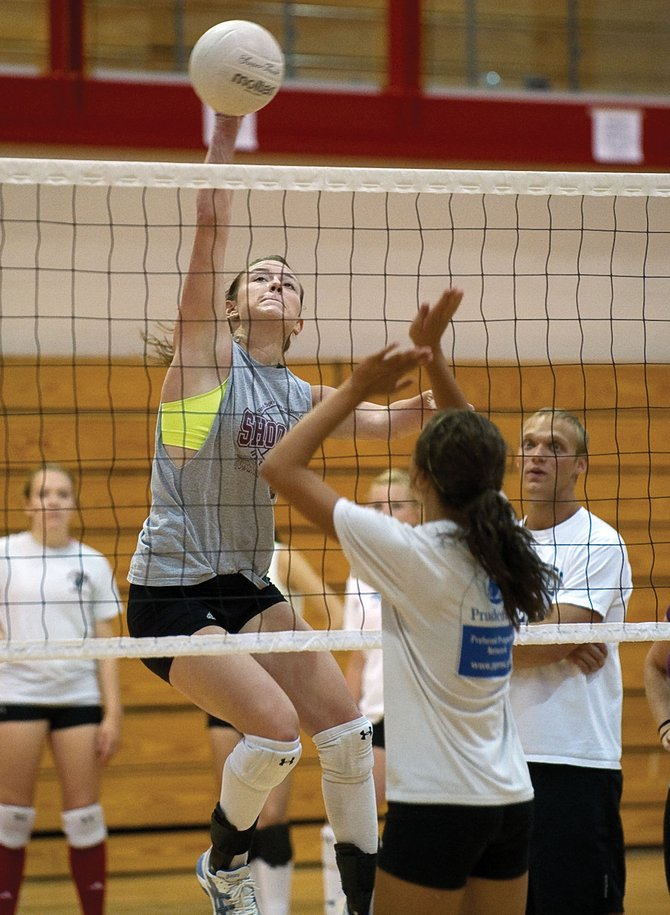 Meghan Rabbitt pounds the ball over a net during a volleyball conditioning camp last week at Steamboat Springs High School. More than 40 players showed up for the voluntary camp. Official high school practice begins Monday across the state.