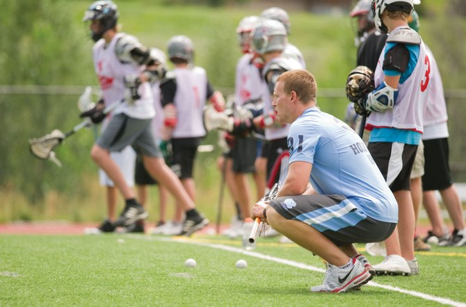 Camp coach Sean Delany, a two-time All-American at the University of North Carolina and a professional player, watches young players run through drills during the Steamboat Lacrosse Camp at Steamboat Springs High School last week.