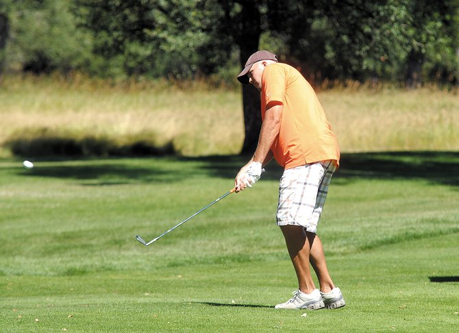 Nick Bomba chips a ball onto the green Sunday during the Yampa Valley Golf Course club championship. Bomba shot 70 on Saturday and Sunday to win the tournament for the fifth time.