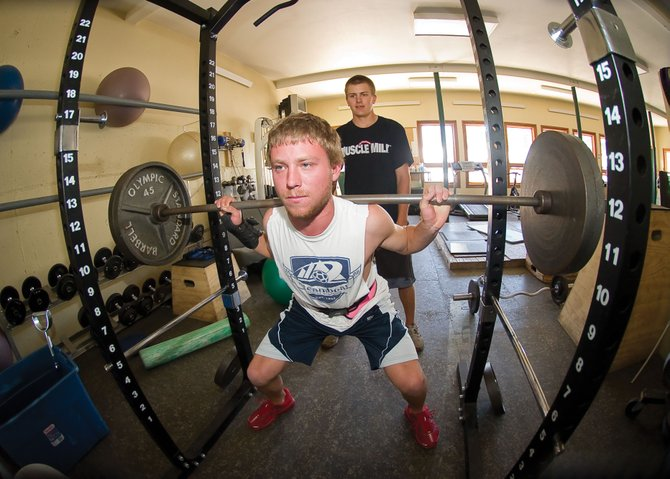 Steamboat Springs' Sam Glaisher, front, and Scott Ptach work out inside the Steamboat Springs Winter Sports Club's weight room. The skiers are taking advantage of the Steamboat Springs Winter Sports Club's post-graduate program to continue to pursue their skiing goals before college.