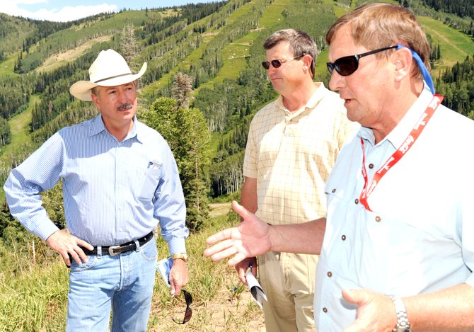 Steamboat Ski Area Vice President of Mountain Operations Doug Allen, right, briefs U.S. Congressman John Salazar, left, on Wednesday about the hurdles the ski area has encountered while trying to manage the pine beetle infestation.