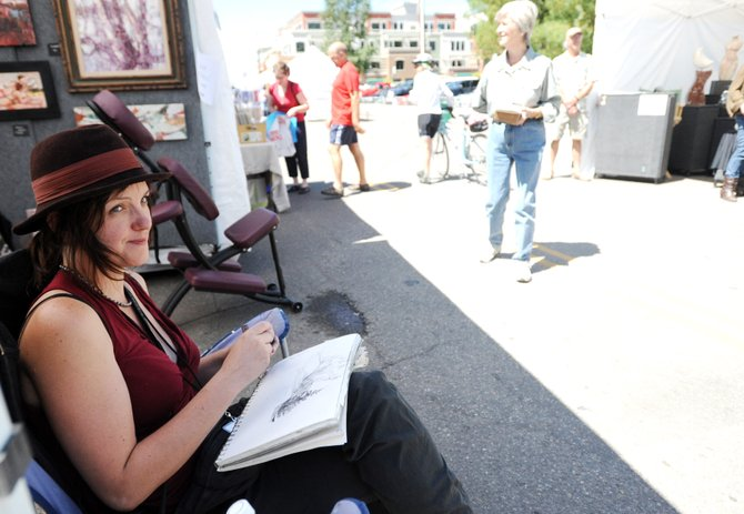 Tiffany Williams, of Denver, studies the details of a scene she was drawing Friday during the first day of the Yampa River Art Stroll, part of the Steamboat All Arts Festival in downtown Steamboat Springs. The festival continues today and wraps up Sunday.