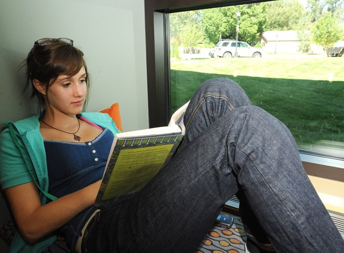 Anna Jones reads a book Friday in Bud Werner Memorial Library in Steamboat Springs. The library will be starting a new program, Story-time for Grownups.