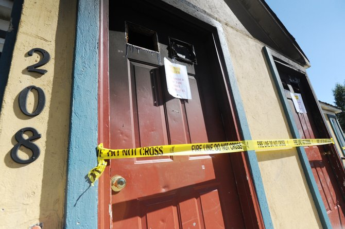 A notice is posted on the door of the downtown Steamboat Springs duplex that burned in a fire last week. The immigration status of some residents is unclear.