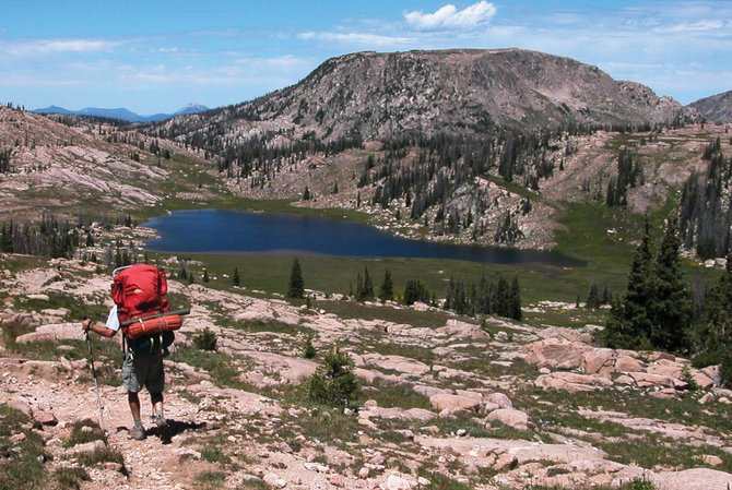 A hiker descends from 11,000 feet on the Continental Divide Trail toward Elbert Lake this month. Luna Lake, substantially larger than Elbert, is just out of sight to the left, and Lake of the Crags is tucked up against the unnamed 11,577-foot peak to the right.