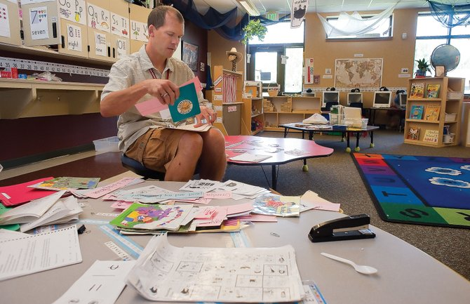 Kindergarten teacher Grady Turner prepares his classroom for Wednesday, when students will return to school for the first day of the 2010-11 academic year in Steamboat Springs.