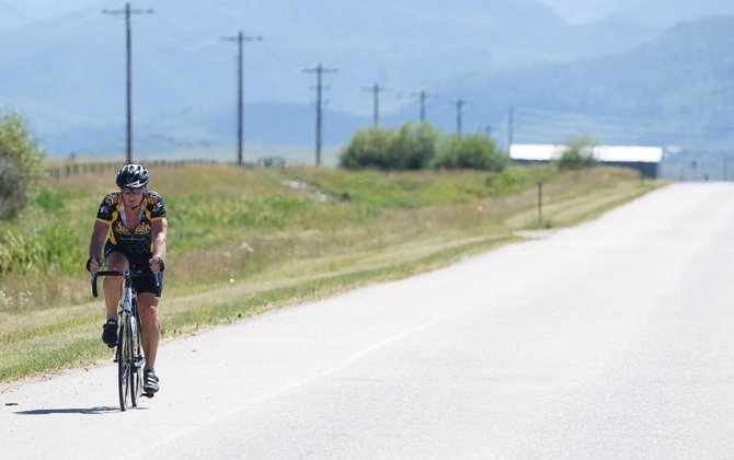 Rod Morgan rides his bike on a stretch of Colorado Highway 131 near the intersection with U.S. Highway 40.