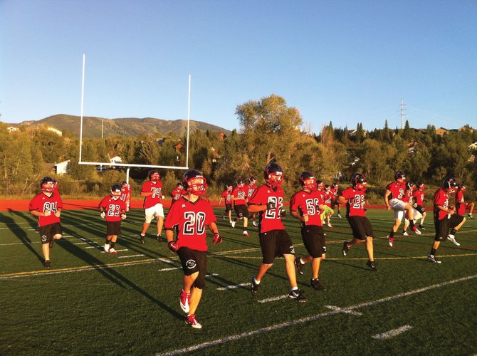 Members of the Steamboat Springs High School football team warm up during practice Thursday. The Sailors open their season at 7 p.m. today at Gardner Field.