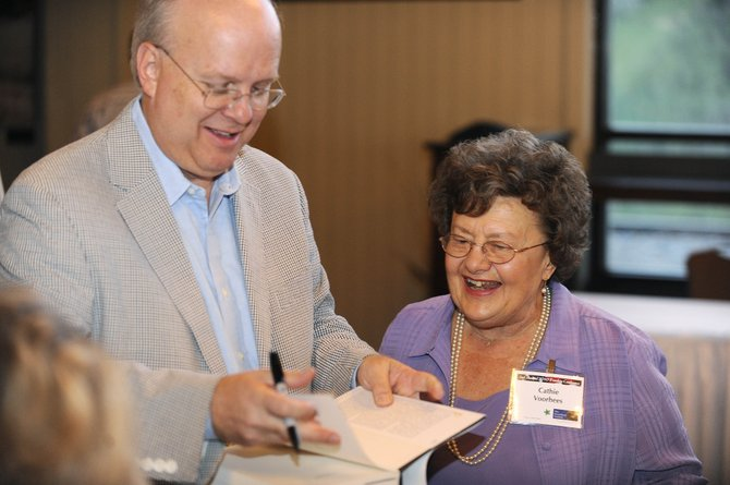 Karl Rove signs Yampa resident Cathie Voorhees' copy of his book during Steamboat Institute's second annual Freedom Conference on Friday night at Thunderhead.