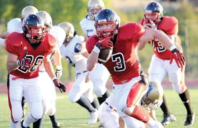 Steamboat Springs' running back Connor Landusky finds some running room in the first half of Friday night's football game at Gardner Field. Despite the strong run, the Sailors lost the game, 36-0, to the Olathe Pirates.