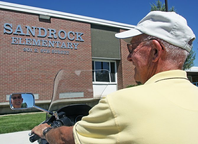 Don Riley takes a long look at the entrance of Sandrock Elementary School, where he will serve as interim principal later in the year. The building, which has undergone numerous name changes, is where Riley began teaching in Craig in 1964. He retired in 2003 after nearly 40 years as a teacher, assistant principal and athletic director in the Moffat County School District.