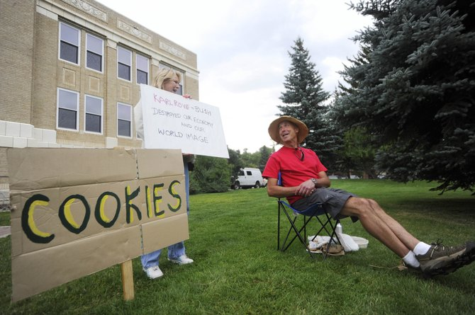 Stuart Handloff and part-time Steamboat Springs resident Jody Robinson talk Saturday during a demonstration on the Routt County Courthouse lawn. Handloff organized the free cookie exchange to protest the agenda of Karl Rove and this weekend's conservative Freedom Conference.