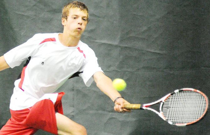 Steamboat's Keegan Burger tracks down a ball Saturday as he improves his No. 1 singles record to 4-0 on the season, winning in a team dual against Kent Denver.