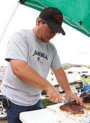 Adrian Nelson, of Craig, prepares his brisket a few moments before turning it in for judging Saturday during the Colorado BBQ Championship at the Wyman Museum. Nelson earned fourth place honors in the chicken category.