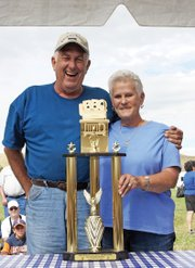 Johnny Trigg and his wife, Peggy, won the grand champion trophy Saturday during the Colorado BBQ Championship at Wyman Museum. Triggs team, Smokin Triggers, of Alvarado, Texas, is the only two-time winner at the Jack Daniels BBQ contest in Tennessee.