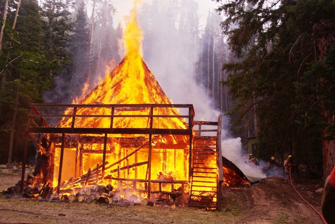 Firefighters from Craig/Fire Rescue, the Bureau of Land Management and the Moffat County Sheriff's Office arrived Saturday afternoon to a fully-involved cabin fire in Wilderness Ranch, about 35 miles north of Craig. The blaze destroyed the cabin.