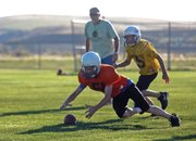 Bronc Hellander dives for a fumble during a Craig Parks and Recreation fifth- and sixth-grade Doak Walker football game Tuesday at Woodbury Sports Complex. The Bengals beat the Steelers 19-0.